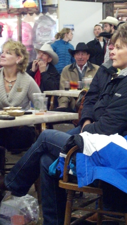 Cowboy poet, Baxter Black was cheering on the Broncos at the Cowboy Bar in the cattle barn in Denver.